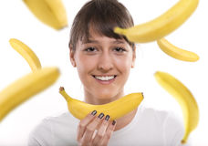 Bananas. Woman with falling bananas. Studio shot with isolated background Stock Images