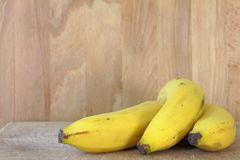 Bananas. On a wood table on kitchen Stock Photography