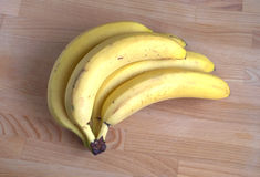 Bananas  on wooden background close-up Stock Images