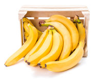 Bananas in wooden crate royalty free stock images