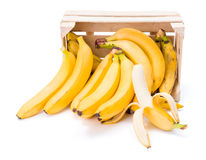 Bananas in wooden crate Stock Image