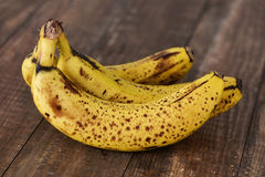 Bananas on a wooden surface. Closeup of a bunch of ripe bananas on a wooden surface Stock Photo
