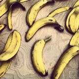 Bananas on wooden table Stock Photography