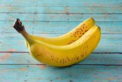 Bananas on a wooden table. Bananas on a wooden picnic table Royalty Free Stock Photography