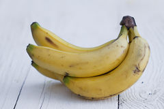 Bananas on wooden table Stock Photos