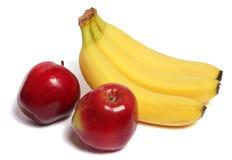 Banane avec la pomme rouge sur le blanc Photo libre de droits