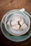 Banane en lait de noix de coco Images stock