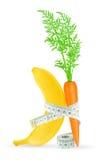 Banane et carotte avec le mètre Photo libre de droits