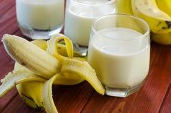 Banane et lait Photo stock