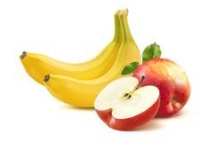 Banane et pomme sur le fond blanc Photographie stock libre de droits