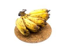 Banane mit Form oder Pilze auf dem weißen Hintergrund Stockfotografie