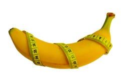 Banane mit messendem Band Stockfoto