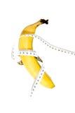 Banane mit Meter Stockfotos