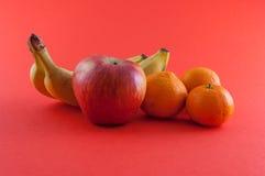Banane, pomme et mandarine Image libre de droits