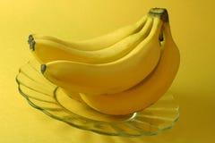 Banane, priorità bassa gialla. Fotografia Stock