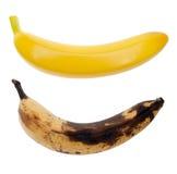 Banane reali ed artificiali immagini stock