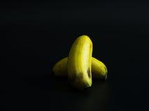 Banane su una priorità bassa nera Immagine Stock Libera da Diritti
