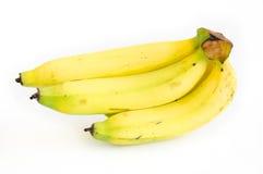 Banane sui precedenti bianchi Immagini Stock