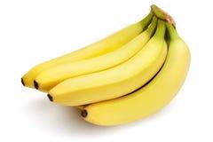 Banane sui precedenti bianchi Fotografia Stock Libera da Diritti