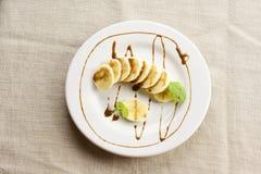Banane und Schokolade lizenzfreie stockfotos