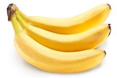 Bananen bär frukt över vit Arkivfoto