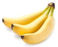 Bananen bär frukt över vit arkivbilder