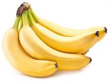 Bananen bär frukt på över vit