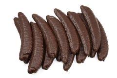 Bananen in der Schokolade auf einem weißen Hintergrund Lizenzfreies Stockbild