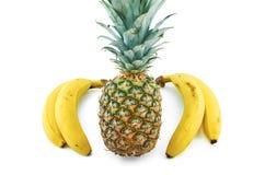 Bananen en ananas op wit worden geïsoleerd dat royalty-vrije stock foto
