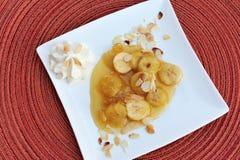 Bananen mit Honig Stockbilder