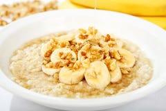 Bananen-Mutteren-Hafermehl mit Honig Stockfotos