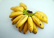 Bananen nannten Dame fingger auf Weiß stockbild