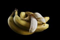 Bananen op een zwarte achtergrond Royalty-vrije Stock Afbeelding