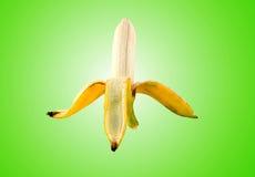 Bananen-Schalen-Licht ein grüner Hintergrund Stockbild