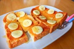 Bananen- und Honigtoast Stockfotos