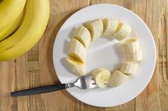 Bananer i platta Arkivbild