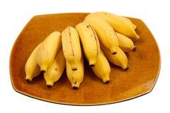 Bananer på maträtten Royaltyfri Foto