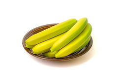 Bananer på maträtten på vit bakgrund Fotografering för Bildbyråer