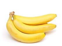 bananer samlar ihop isolerad white Arkivbilder