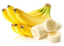 Bananer som isoleras på den vita bakgrunden Arkivfoto