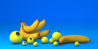 Bananes avec la décoration de jouets sur le fond bleu Photographie stock libre de droits