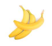 Bananes jaunes entières, organiques, fraîches et lumineuses, d'isolement sur un fond blanc Fruit de trois bonbons des bananes Photos stock