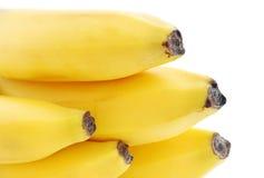 Bananes sur le fond blanc Photo stock