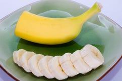 Bananowa połówka i plasterki Zdjęcie Stock