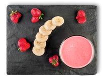 Bananowi truskawkowi smoothies zdjęcie royalty free