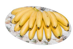 Banans branch  on plate Stock Image