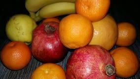 Banany, granatowowie, mandarynki, pigwa Obrazy Stock