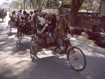 BANARAS: schoolrickshaws in colour. In Banaras too there are elite schools and the level is proportionate with the neatness of the uniform.n Stock Image