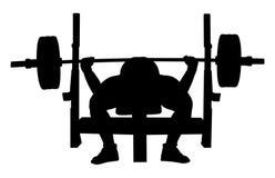 Banc à presse de powerlifter d'athlète Image libre de droits