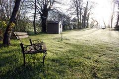 Banc dans le lever de soleil Photos libres de droits